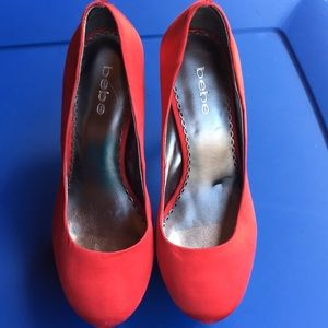 Great used condition red Bebe heels size 8M
